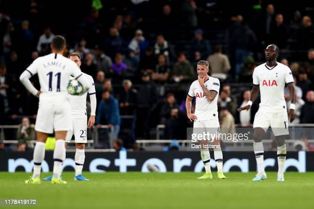 Erik Lamela Christian Eriksen Toby Alderweireld and Moussa Sissoko of Tottenham Hotspur look dejected following their sides defeat in the UEFA...