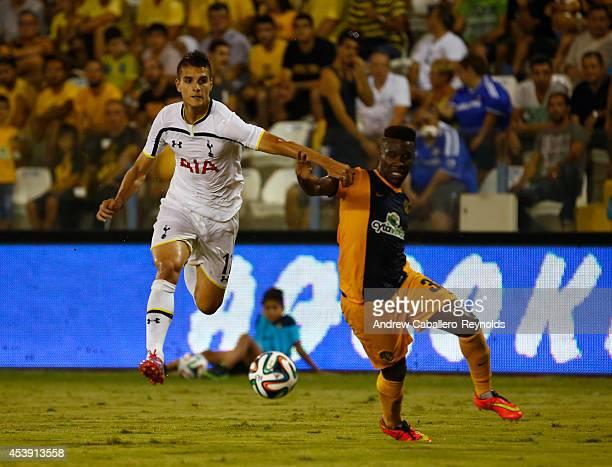 Erik Lamela from Tottenham Hotspur tries to get past Samba Guidileye Dialo from AEL Limassol FC during the AEL Limassol FC v Tottenham Hotspur UEFA...