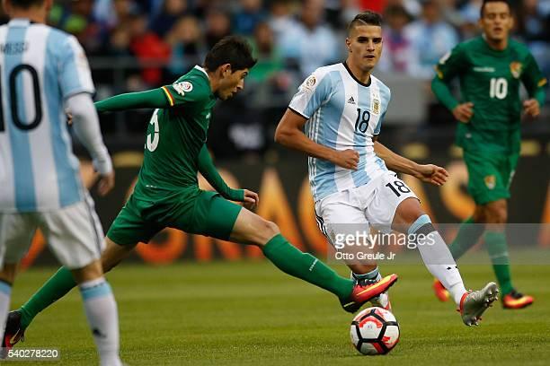 Erik Lamela of Argentina battles Pedro Azogue of Bolivia during the 2016 Copa America Centenario Group D match at CenturyLink Field on June 14 2016...