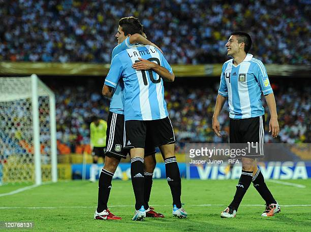 Erik Lamela of Argentina celebrates scoring from the penalty spot with his teammates during the FIFA U20 World Cup Colombia 2011 round of 16 match...