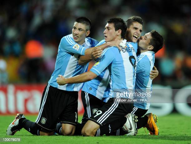 Erik Lamela of Argentina celebrates scoring the opening goal with his teammates during the FIFA U20 World Cup Colombia 2011 group F match between...