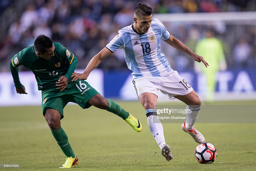 Erik Lamela of Argentina dribbles the ball as Cristhian Machado of Bolivia challenges him during a group D match between Argentina and Bolivia at CenturyLink Field as part of Copa America Centenario US 2016 on June 14, 2016 in Seattle, Washington, US.