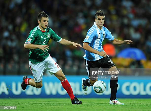 Erik Lamela of Argentina runs for the ball with Kristian Alvarez of Mexico during the FIFA U20 World Cup Colombia 2011 group F match between...