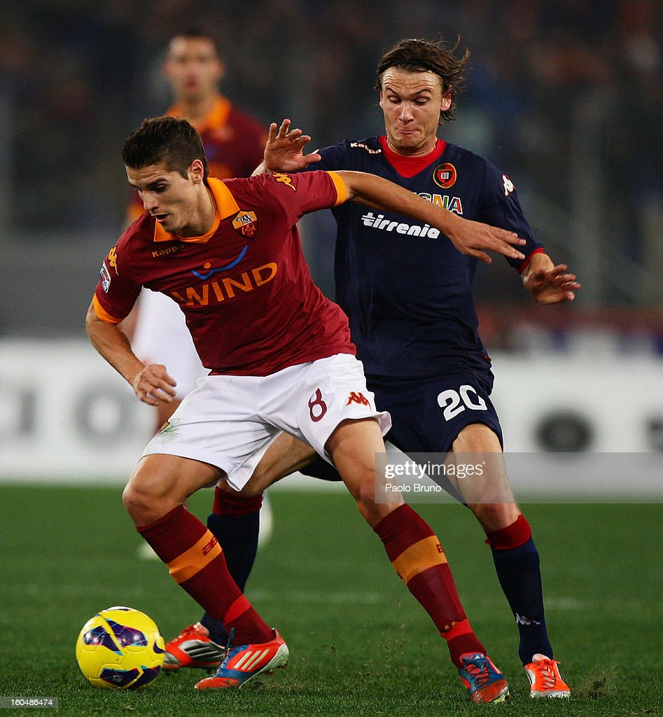 Erik Lamela (L) of AS Roma competes for the ball with Albin Ekdal of Cagliari Calcio during the Serie A match between AS Roma and Cagliari Calcio at Stadio Olimpico on February 1, 2013 in Rome, Italy.