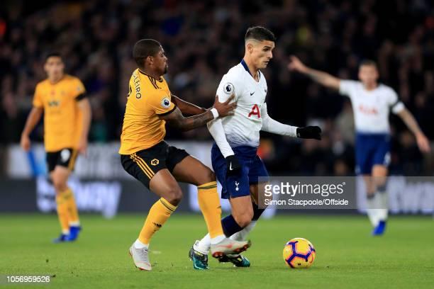 Erik Lamela of Spurs battles with Ivan Cavaleiro of Wolves during the Premier League match between Wolverhampton Wanderers and Tottenham Hotspur at...