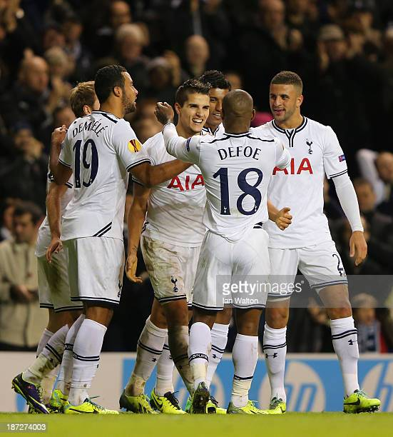 Erik Lamela of Spurs celebrates scoring their first goal with team mates during the UEFA Europa League Group K match between Tottenham Hotspur FC and...