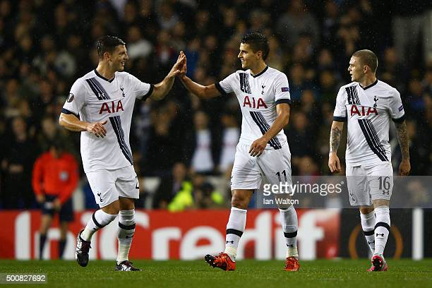 Erik Lamela of Spurs celebrates with teammates Kevin Wimmer after scoring his team's second goal during the UEFA Europa League Group J match between...