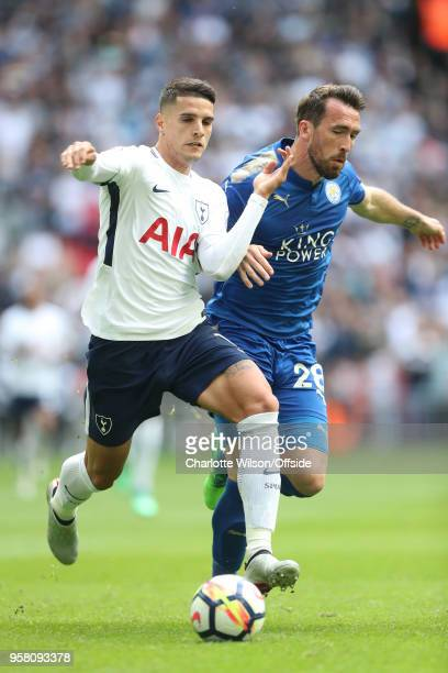Erik Lamela of Tottenham and Christian Fuchs of Leicester battle for the ball during the Premier League match between Tottenham Hotspur and Leicester...