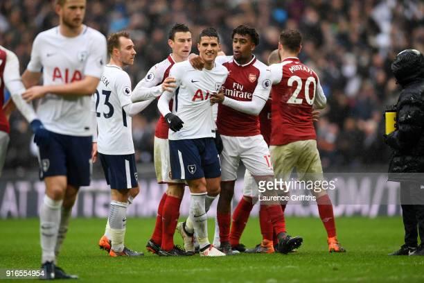 Erik Lamela of Tottenham Hotspur and Alex Iwobi of Arsenal argue during the Premier League match between Tottenham Hotspur and Arsenal at Wembley...