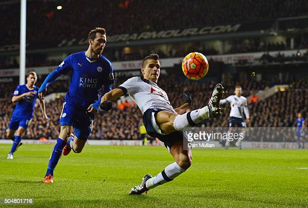 Erik Lamela of Tottenham Hotspur and Christian Fuchs of Leicester City compete for the ball during the Barclays Premier League match between...