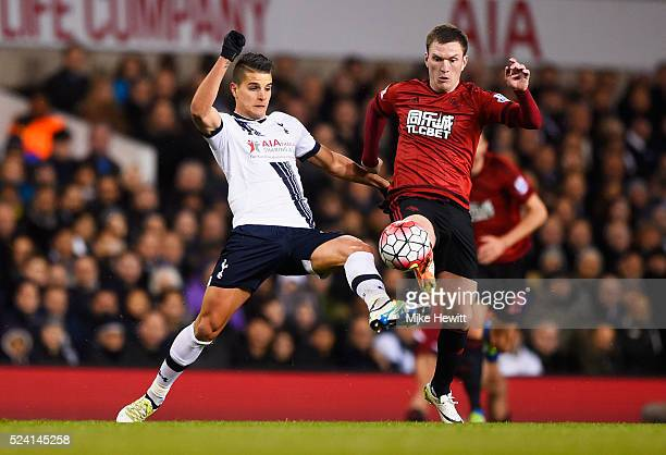 Erik Lamela of Tottenham Hotspur and Craig Gardner of West Bromwich Albion battle for the ball during the Barclays Premier League match between...