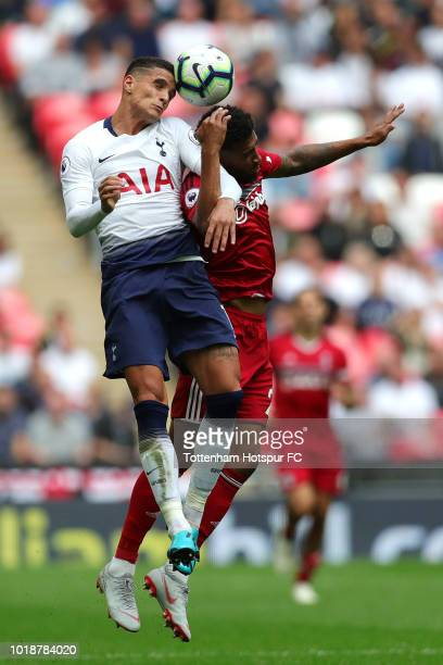 Erik Lamela of Tottenham Hotspur and Cyrus Christie of Fulham battle for the header during the Premier League match between Tottenham Hotspur and...