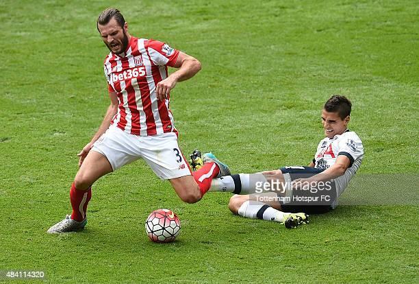 Erik Lamela of Tottenham Hotspur and Erik Pieters of Stoke City battle for the ball during the Barclays Premier League match between Tottenham...