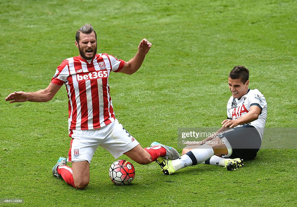 Erik Lamela of Tottenham Hotspur and Erik Pieters of Stoke City battle for the ball during the Barclays Premier League match between Tottenham Hotspur and Stoke City at White Hart Lane on August 15, 2015 in London, United Kingdom.