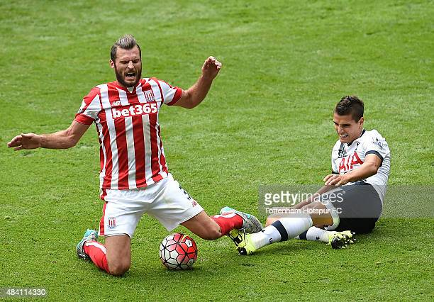 Erik Lamela of Tottenham Hotspur and Erik Pieters of Stoke City battle for the ball during the Barclays Premier League match between Tottenham...