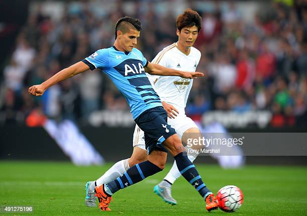 Erik Lamela of Tottenham Hotspur and Ki Sung-Yeung of Swansea City during the Barclays Premier League match between Swansea City and Tottenham...