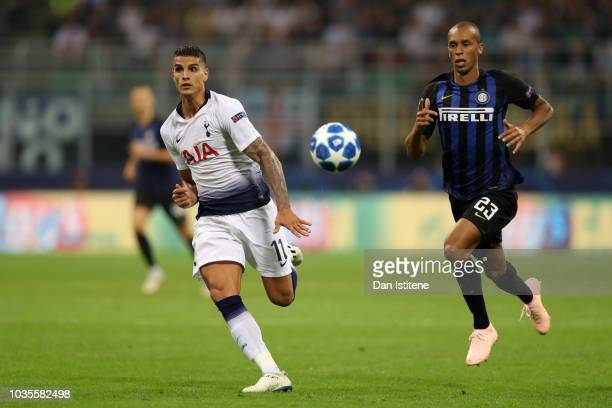 Erik Lamela of Tottenham Hotspur and Miranda of Inter Milan chase the ball during the Group B match of the UEFA Champions League between FC...