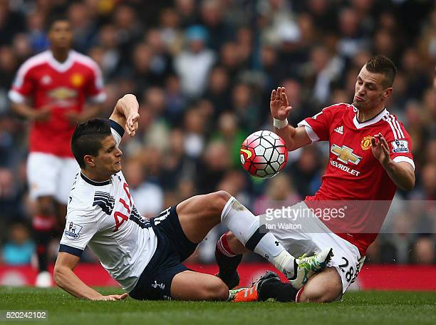 Erik Lamela of Tottenham Hotspur and Morgan Schneiderlin of Manchester United battle for ball during the Barclays Premier League match between...