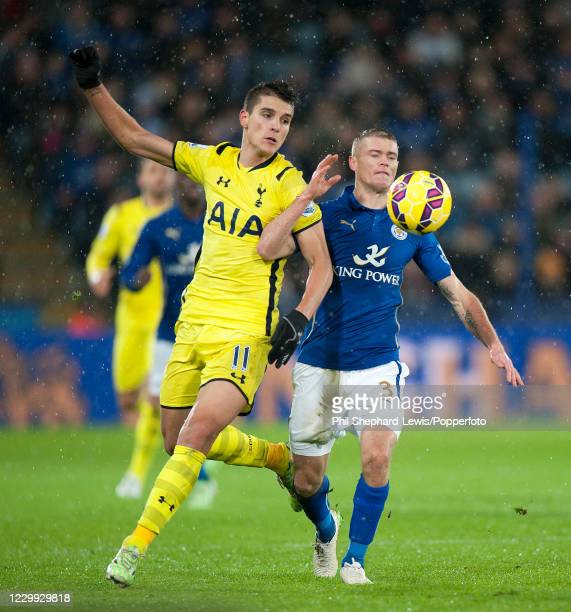 Erik Lamela of Tottenham Hotspur and Paul Konchesky of Leicester City compete for the ball during a Barclays Premier League match at the King Power...