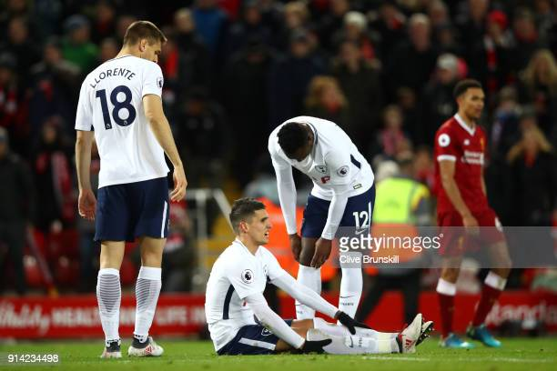 Erik Lamela of Tottenham Hotspur and Victor Wanyama of Tottenham Hotspur look dejected during the Premier League match between Liverpool and...