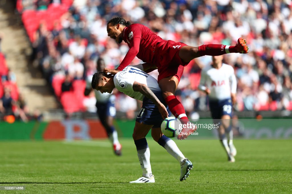 Erik Lamela of Tottenham Hotspur and Virgil van Dijk of Liverpool clash during the Premier League match between Tottenham Hotspur and Liverpool FC at Wembley Stadium on September 15, 2018 in London, United Kingdom.