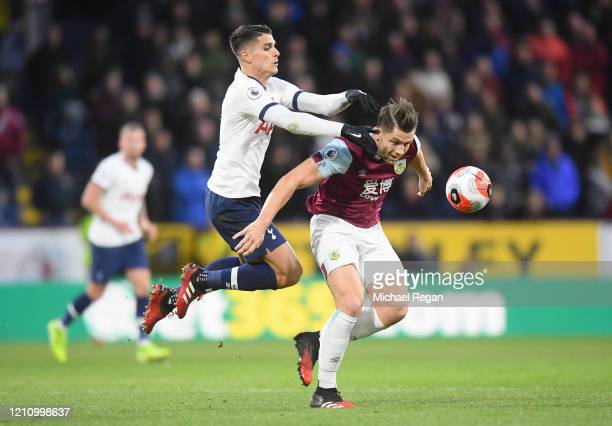 Erik Lamela of Tottenham Hotspur battles for possession with James Tarkowski of Burnley during the Premier League match between Burnley FC and...