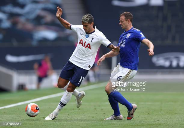 Erik Lamela of Tottenham Hotspur battles for possession with Jonny Evans of Leicester City during the Premier League match between Tottenham Hotspur...