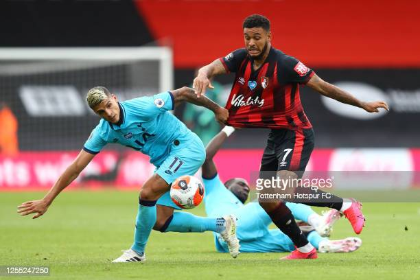 Erik Lamela of Tottenham Hotspur battles for possession with Joshua King of AFC Bournemouth during the Premier League match between AFC Bournemouth...
