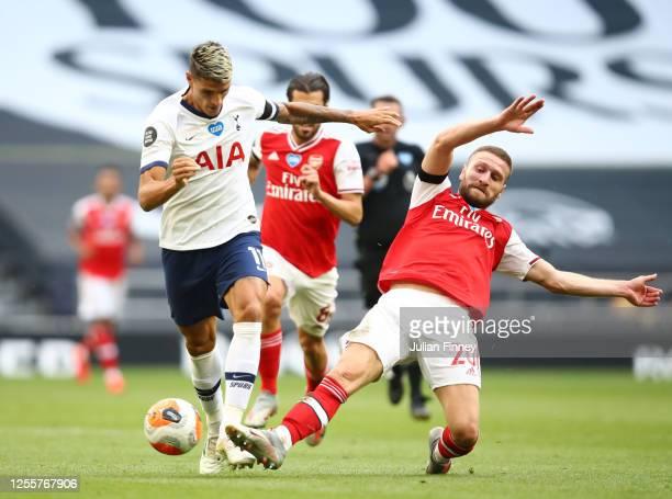 Erik Lamela of Tottenham Hotspur battles for possession with Shkodran Mustafi of Arsenal during the Premier League match between Tottenham Hotspur...