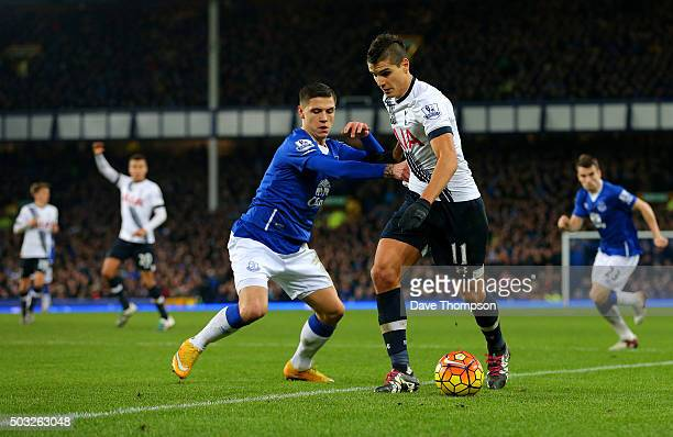 Erik Lamela of Tottenham Hotspur battles for the ball with Muhamed Besic of Everton during the Barclays Premier League match between Everton and...
