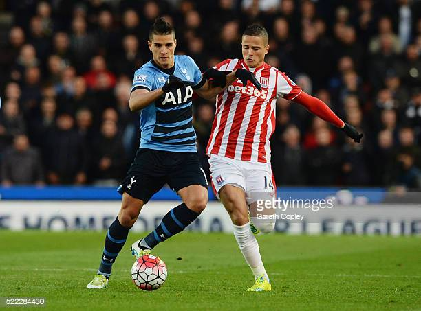 Erik Lamela of Tottenham Hotspur battles with Ibrahim Afellay of Stoke City during the Barclays Premier League match between Stoke City and Tottenham...