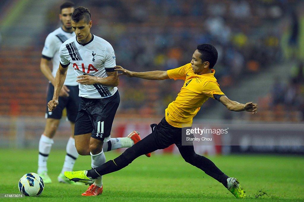 Erik Lamela of Tottenham Hotspur battles with Mohd Nasir of Malaysia XI during the pre-season friendly match between Malaysia XI and Tottenham Hotspur at Shah Alam Stadium on May 27, 2015 in Shah Alam, Malaysia.