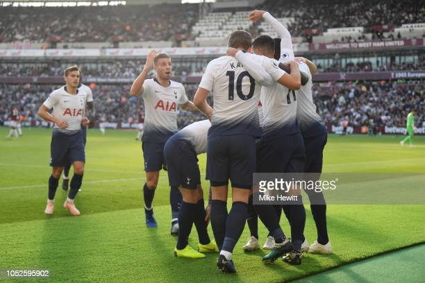 Erik Lamela of Tottenham Hotspur celebrates after scoring his team's first goal with his team mates during the Premier League match between West Ham...