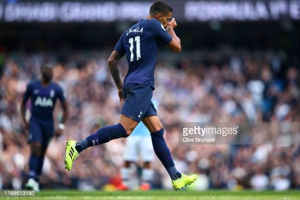 Erik Lamela of Tottenham Hotspur celebrates after scoring his team's first goal during the Premier League match between Manchester City and Tottenham...