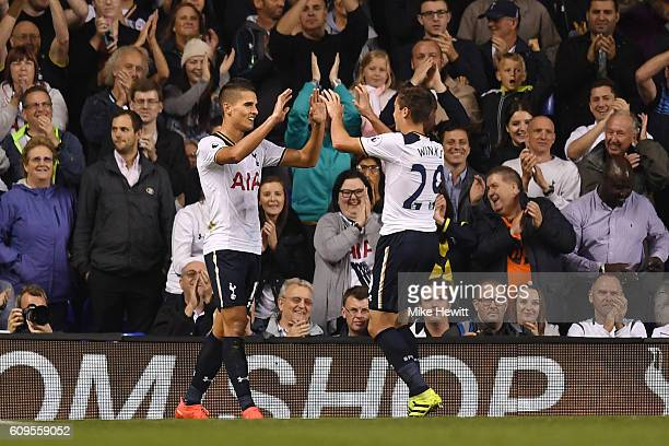 Erik Lamela of Tottenham Hotspur celebrates scoring his sides fifth goal with Harry Winks of Tottenham Hotspur during the EFL Cup Third Round match...