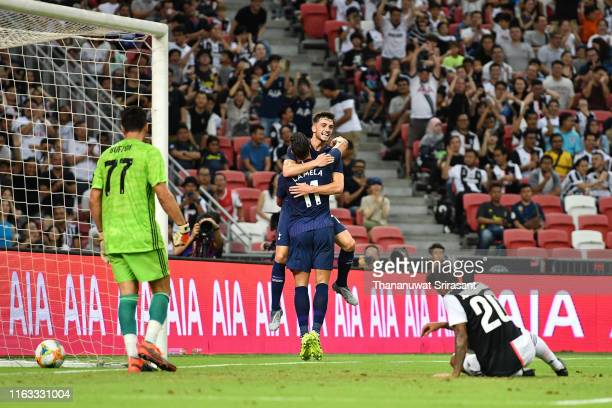 Erik Lamela of Tottenham Hotspur celebrates scoring his side's first goal with his team mate Troy Parrott during the International Champions Cup...