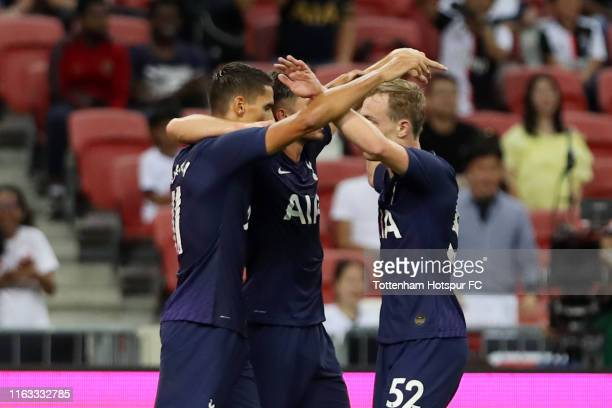 Erik Lamela of Tottenham Hotspur celebrates scoring his side's first goal with his team mates during the International Champions Cup match between...