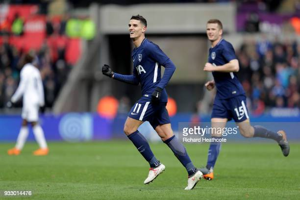 Erik Lamela of Tottenham Hotspur celebrates scoring his side's second goal during The Emirates FA Cup Quarter Final match between Swansea City and...
