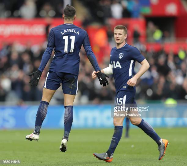 Erik Lamela of Tottenham Hotspur celebrates scoring his side's second goal with Eric Dier during The Emirates FA Cup Quarter Final match between...