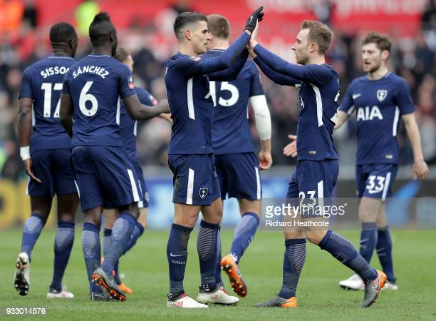 Erik Lamela of Tottenham Hotspur celebrates scoring his side's second goal with team mates during The Emirates FA Cup Quarter Final match between...