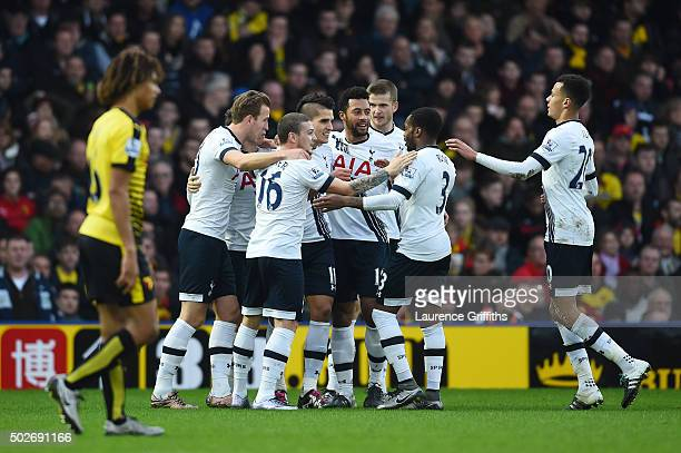 Erik Lamela of Tottenham Hotspur celebrates scoring his team's first goal with his team mates during the Barclays Premier League match between...