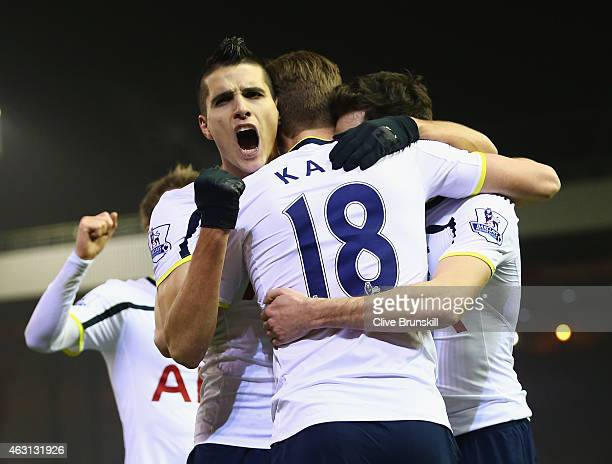 Erik Lamela of Tottenham Hotspur celebrates the goal scored by Harry Kane during the Barclays Premier League match between Liverpool and Tottenham...