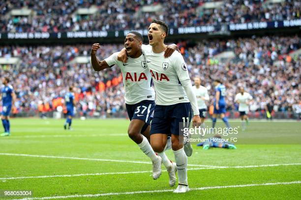 Erik Lamela of Tottenham Hotspur celebrates with Kyle WalkerPeters of Tottenham Hotspur after scoring his sides fourth goal during the Premier League...