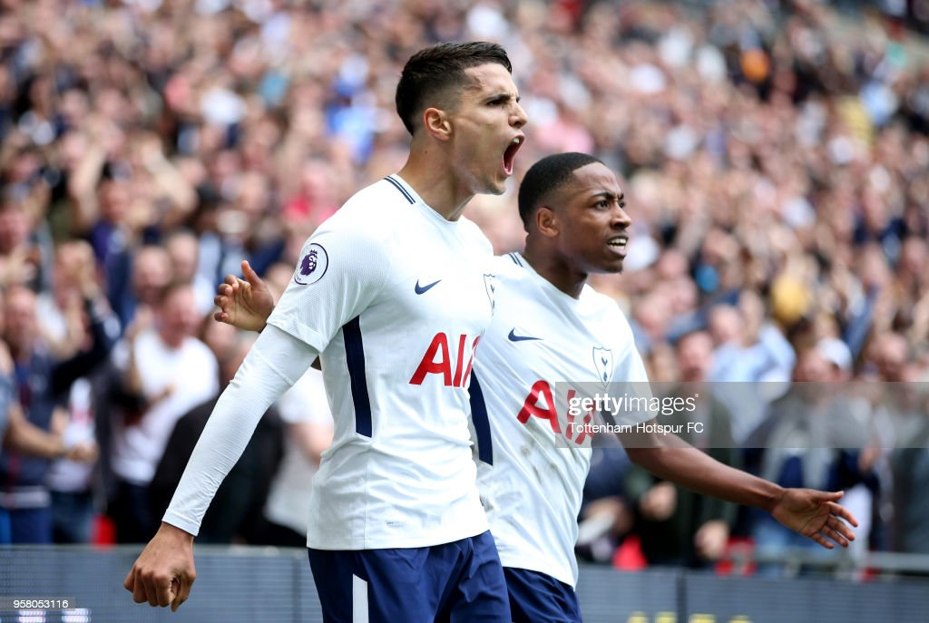 Erik Lamela of Tottenham Hotspur celebrates with Kyle Walker-Peters of Tottenham Hotspur after scoring his sides fourth goal during the Premier League match between Tottenham Hotspur and Leicester City at Wembley Stadium on May 13, 2018 in London, England.