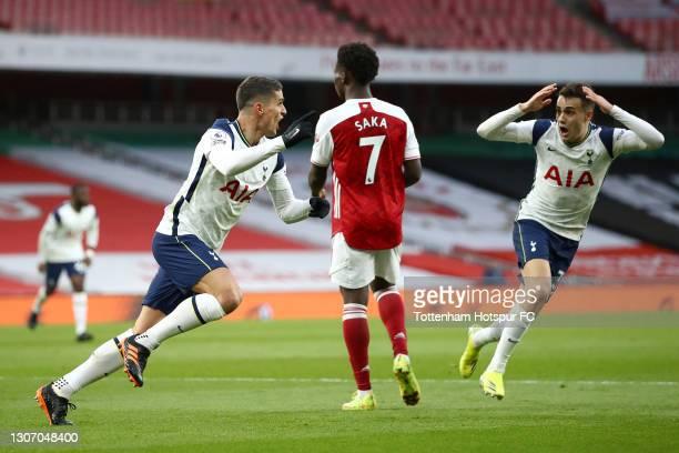 Erik Lamela of Tottenham Hotspur celebrates with team mate Sergio Reguilon after scoring their side's first goal during the Premier League match...