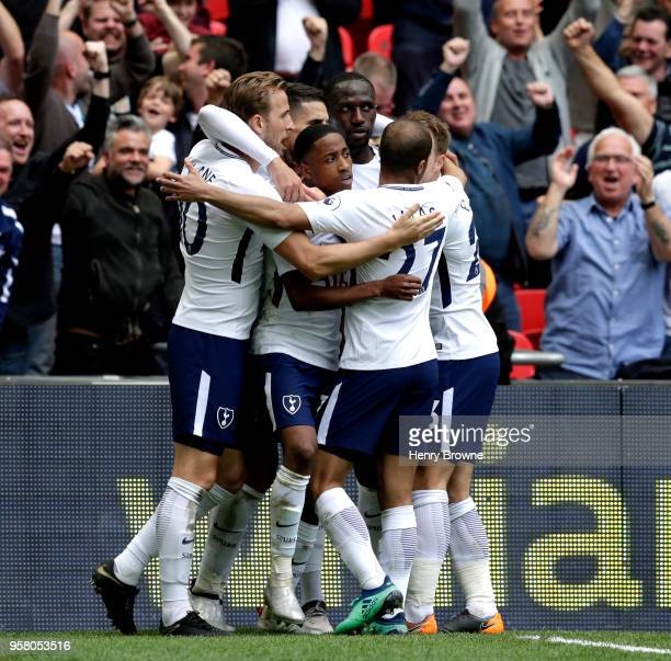 Erik Lamela of Tottenham Hotspur celebrates with teammates after scoring his sides fourth goal during the Premier League match between Tottenham...