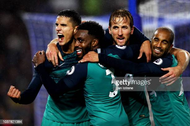 Erik Lamela of Tottenham Hotspur celebrates with teammates Danny Rose Harry Kane and Lucas Moura after scoring his team's second goal during the...