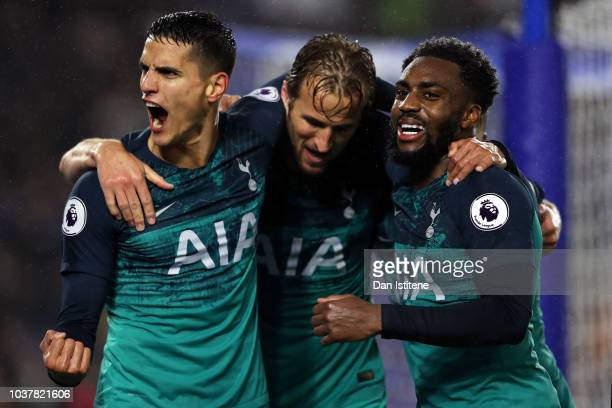 Erik Lamela of Tottenham Hotspur celebrates with teammates Danny Rose and Harry Kane after scoring his team's second goal during the Premier League...