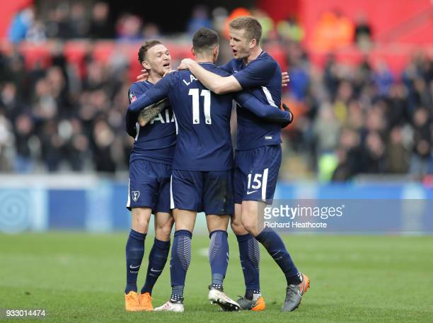 Erik Lamela of Tottenham Hotspur celebrates with teammates Kieran Trippier and Eric Dier after scoring his sides second goal during The Emirates FA...