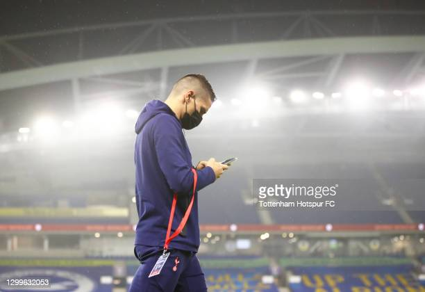 Erik Lamela of Tottenham Hotspur checks his phone as he arrives prior to the Premier League match between Brighton & Hove Albion and Tottenham...